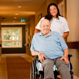 Client on wheelchair with staff